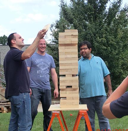 Men Outdoors Playing Yard Game